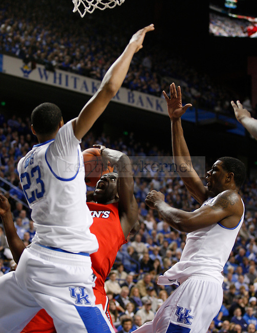 Anthony Davis and Terrence Jones surround a St. Johns player during the game at Rupp Arena, in Lexington, Ky., on Thursday, Dec. 1, 2011. Photo by Latara Appleby | Staff ..