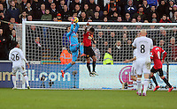 SWANSEA, WALES - FEBRUARY 21: Goalkeeper Lukasz Fabianski of Swansea catches the ball over Marcos Rojo of Manchester during the Barclays Premier League match between Swansea City and Manchester United at Liberty Stadium on February 21, 2015 in Swansea, Wales.