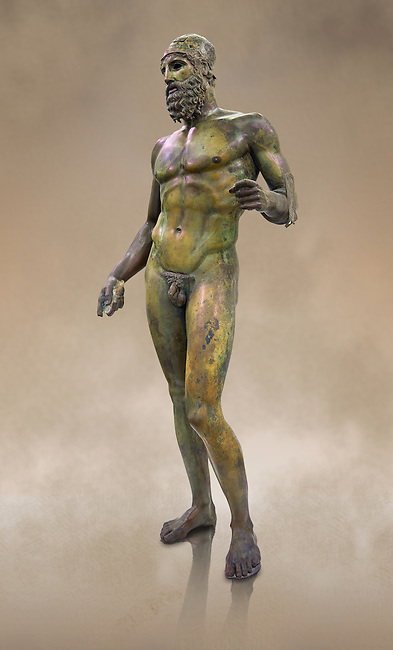 Full length side view of the Riace bronze Greek statue B cast about 460 - 450 BC. statue B was probably sculpted by Phidias. There is a sense of movement in the statues their legs being bent as if they are about to take a step. Their heads are turned which accentuates a sense of anticipation as if they are looking for something. The anatomical detail is extraordinary which gives a startling realism to the statue and demonstarte the high level of skill of the Greek sculptors of this peiod. Museo Nazionale della Magna Grecia,  Reggio Calabria, Italy.