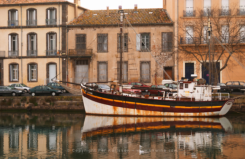 L'Herault river. A fishing boat. Agde town. Languedoc. France. Europe.