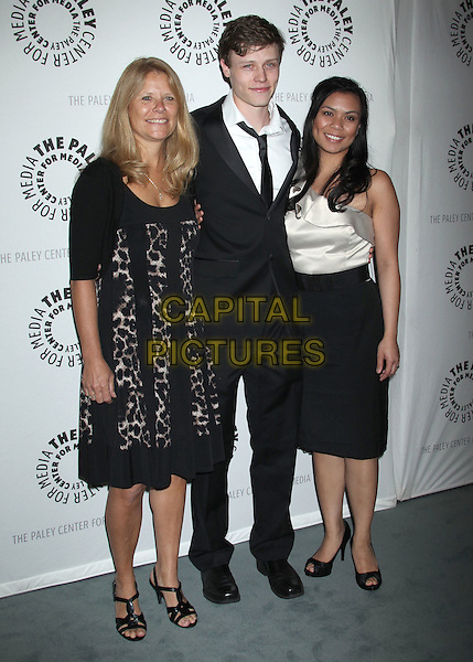 "Donna Eversman, Nick Eversman, Emily Eversman.""Missing"" Premiere Screening presented by The Paley Center for Media held at The Paley Center For Media, Beverly Hills, California, USA..April 10th, 2012.full length black dress suit skirt white top.CAP/ADM/RE.©Russ Elliot/AdMedia/Capital Pictures."