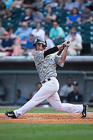 Jeremy Farrell (48) of the Birmingham Barons follows through on his swing against the Tennessee Smokies at Regions Field on May 3, 2015 in Birmingham, Alabama.  The Smokies defeated the Barons 3-0.  (Brian Westerholt/Four Seam Images)
