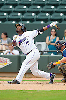 Courtney Hawkins (10) of the Winston-Salem Dash hits a pop up against the Myrtle Beach Pelicans at BB&T Ballpark on July 7, 2013 in Winston-Salem, North Carolina.  The Pelicans defeated the Dash 4-2 in game one of a double-header.  (Brian Westerholt/Four Seam Images)