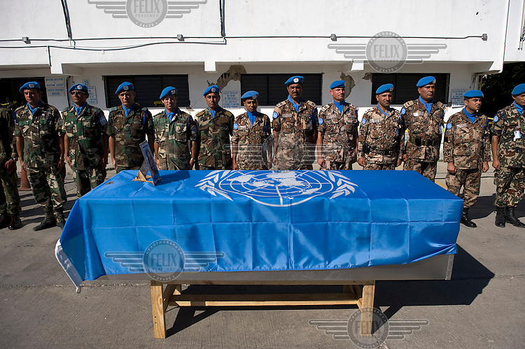 At the UN Minustah compound in Port-au-Prince, a ceremony takes place for three Filipino UN employees who died in the earthquake. .A 7.0 magnitude earthquake struck Haiti on 12/01/2010. Early reports indicated that more than 100,000 may have been killed and three million affected.