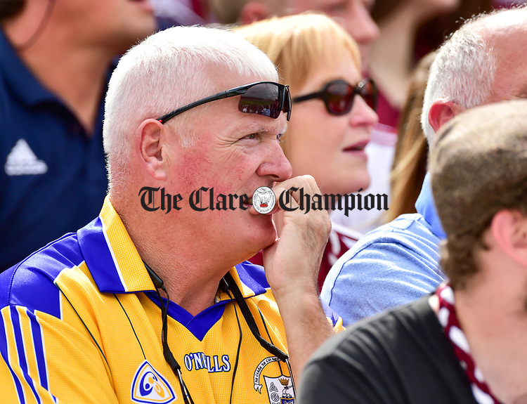 A tense Clare fan during their All-Ireland semi-final replay against Galway at Semple Stadium, Thurles. Photograph by John Kelly.