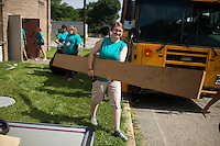 "Members remove trash during ""Circle the City with Service,"" the Kiwanis Circle K International's 2015 Large Scale Service Project, on Wednesday, June 24, 2015, at the Friendship Westside Center for Excellence in Indianapolis. (Photo by James Brosher)"