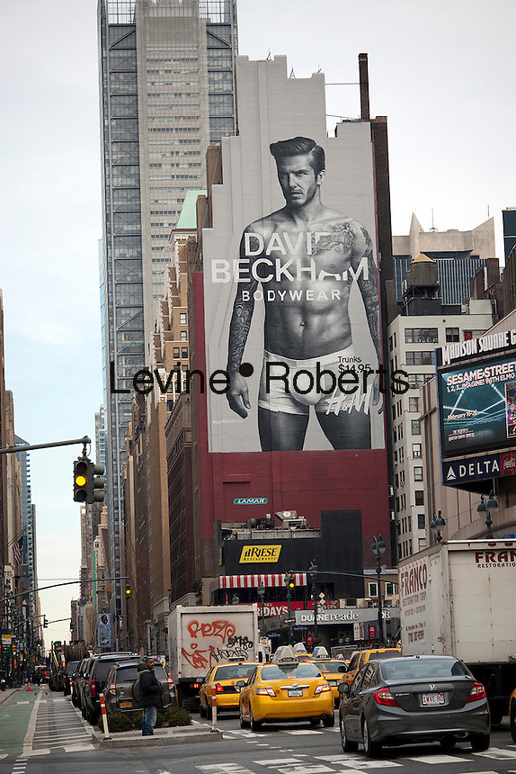 A giant blow-up of soccer star David Beckham in his skivvies promoting his line of underwear at H&M is seen on a billboard in New York on Wednesday, February 8, 2012.  H&M is carrying the soccer athlete's underwear collection. The store has also featured mass-market fashion by designers Versace, Karl Lagerfeld, Stella McCartney among others.  (© Richard B. Levine)