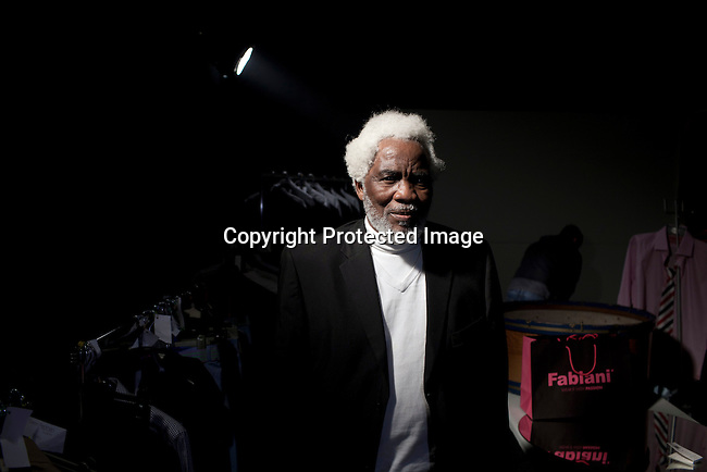 CAPE TOWN, SOUTH AFRICA - JULY 27: A male senior model waits backstage before a fashion show with the designer label Fabiani at the Mercedes Benz Cape Town Fashion Week on July 27, 2012, in Cape Town, South Africa. Some of South Africa's finest designers showed their 2012-13 spring and summer collections during the 4-day event. (Photo by Per-Anders Pettersson)