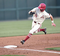 NWA Democrat-Gazette/J.T. WAMPLER Arkansas' Casey Martin rounds third base on his way to score in the third inning against ORU Tuesday April 9, 2019 at Baum-Walker Stadium in Fayetteville.