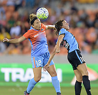 Amber Brooks (12) of the Houston Dash wins a header over Vanessa DiBernardo (10) of the Chicago Red Stars in the first half on Saturday, April 16, 2016 at BBVA Compass Stadium in Houston Texas.