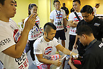 Dae Hwan Kim, Kamma Bantam weight champion, getting hands bandaged in locker room before fight<br /><br />MMA. Mixed Martial Arts &quot;Tigers of Asia&quot; cage fighting competition. Top professional male and female fighters from across Asia, Russia, Australia, Malaysia, Japan and the Philippines come together to fight. This tournament takes place in front of a ten thousand strong crowd of supporters in Pelaing Stadium. Kuala Lumpur, Malaysia. October 2015