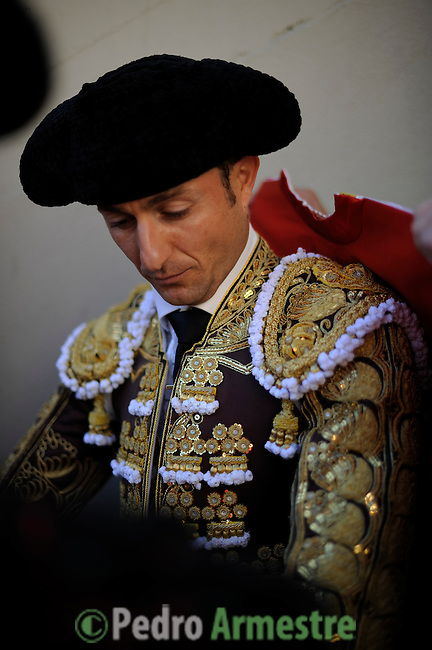 Spanish Matador Javier Rubio looks on before a bullfight during the San Fermin festival at Pamplona's bullring on July 8, 2012, in Pamplona, northern Spain. The festival is a symbol of Spanish culture that attracts thousands of tourists to watch the bull runs despite heavy condemnation from animal rights groups . (c) Pedro ARMESTRE