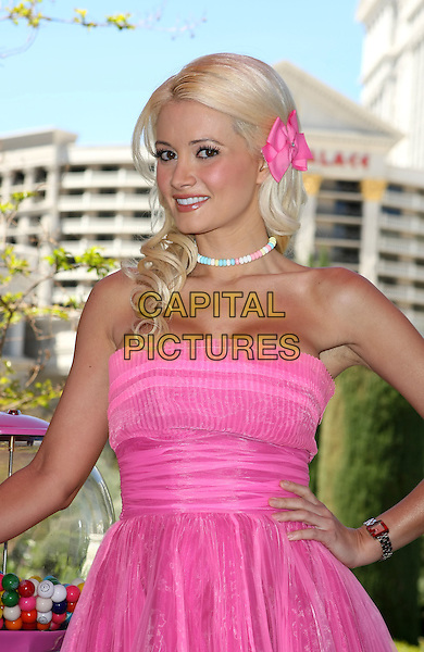 """HOLLY MADISON.announces Mayor Goodman's Proclamation of """"Serendipity 3 Day"""" in Honor of One Year Anniversary of Serendipty 3 at Caesar's Palace Resort Hotel and Casino, Las Vegas, Nevada, USA 6th April 2010.half length pink strapless dress flower in hair candy sweets necklace hand on hip.CAP/ADM/MJT.© MJT/AdMedia/Capital Pictures."""
