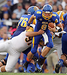 BROOKINGS, SD - SEPTEMBER 14:  Austin Sumner # 6 from South Dakota State University is brought down by Greg Triay #91 from Southeastern Louisiana in the second quarter of their game Saturday night at Coughlin Alumni Stadium in Brookings. (Photo by Dave Eggen/Inertia)