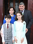 Sinead O'Byrne from LeCheile school who was confirmed in St Mary's church pictured with dad Cahir, mam Roisín and brother Donal. Photo:Colin Bell/pressphotos.ie