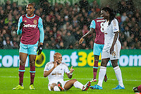 Andre Ayew of Swansea sits on the floor after missing a shot during the Barclays Premier League match between Swansea City and West Ham United played at the Liberty Stadium, Swansea  on December 20th 2015