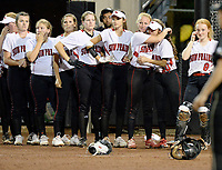 Sun Prairie's Grace Hilber (third from right) hugs Sierra Ek after Saturday's defeat, as Oshkosh North tops Sun Prairie 4-2 in nine innings to win the championship game of the 2019 Division 1 Wisconsin WIAA girls state high school softball tournament on Saturday, June 8, at Goodman Diamond in Madison, Wisconsin