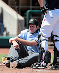 The home plate umpire grimaces after being hit in the leg by a foul ball in a minor league baseball game between the Reno Aces and the Tuscon Padres in Reno, Nev. on Monday, Sept. 3, 2012. The Aces won 2-1..Photo by Cathleen Allison