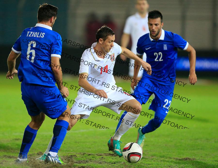 Fudbal<br /> Prijateljski mec-Friendly match<br /> Srbija v Grcka<br /> Nemanja Matic (C) Andreas Samaris (R) <br /> Chania, 18.11.2014.<br /> foto: Srdjan Stevanovic/Starsportphoto &copy;