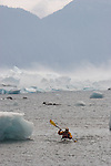 Lone sea kayaker, bad weather, Alaska, Prince William Sound, Columbia Bay, Columbia Glacier icebergs,