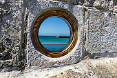 St Ives, Cornwall. View through a port hole in a wall of the lighthouse.