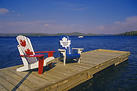 Muskoka chairs on dock at Lake of Bays<br />