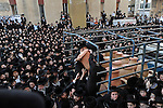 Ultra-Orthodox Jewish men attend a burial ceremony in Bnei Brak, central Israel, for Torah scrolls that were destroyed in a fire, as clay jars with burnt scrolls are uploaded to a truck. Eleven torah scrolls were burnt in a fire that broke out in a synagogue during the Jewish holiday of Sukkot, following a short circuit in the Holy Ark.