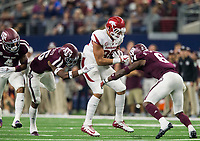 Hawgs Illustrated/Ben Goff<br /> DeShawn Capers-Smith (left) and Donovan Wilson, Texas A&M defenders, tackle Cheyenne O'Grady, Arkansas tight end, in the 4th quarter Saturday, Sept. 29, 2018, during the Southwest Classic at AT&T Stadium in Arlington, Texas.