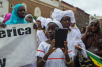 Sengalese immigrants participate in a parade in Harlem in New York commemorating their Shaykh Ahmadou Bamba during the Murid Islamic Community in America (MICA) cultural weeks celebration on Sunday, July 28, 2013. A Murid follows the philosophy of the Sufi Islamic religion and is guided by a murshid, in this case the late Shaykh Ahmadou Bamba who died in 1927. (© Frances M. Roberts)Sengalese immigrants participate in a parade in Harlem in New York commemorating their Shaykh Ahmadou Bamba during the Murid Islamic Community in America (MICA) cultural weeks celebration on Sunday, July 28, 2013. A Murid follows the philosophy of the Sufi Islamic religion and is guided by a murshid, in this case the late Shaykh Ahmadou Bamba who died in 1927. (© Frances M. Roberts)