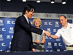 Hideki Matsui,<br /> JULY 28, 2013 - MLB :<br /> Hideki Matsui shakes hands with New York Yankees general manager Brian Cashman as Yankees assistant general manager Jean Afterman looks on during a press conference for signing a one-day minor league contract with the Yankees prior to his official retirement ceremony before the Major League Baseball game against the Tampa Bay Rays at Yankee Stadium in The Bronx, New York, United States. (Photo by AFLO)