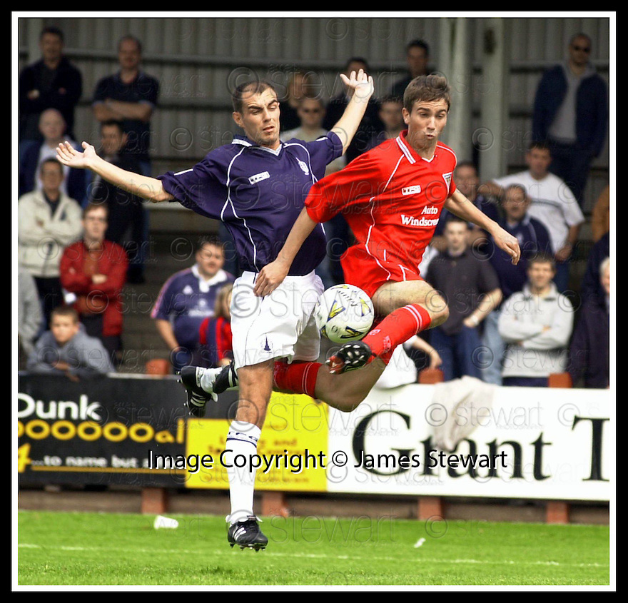 22/07/2001          Copyright Pic : James Stewart .Ref : DSC_4381                          .File Name : stewart 07 : falkirk v dunfermline.JAMIE MCQUILKEN CHALLENGES FOR THE BALL......James Stewart Photo Agency, Stewart House, Stewart Road, Falkirk. FK2 7AS      Vat Reg No. 607 6932 25.Office : +44 (0)1324 630007     Mobile : + 44 (0)7721 416997.Fax     :  +44 (0)1324 630007.E-mail : jim@jspa.co.uk.If you require further information then contact Jim Stewart on any of the numbers above.........