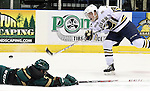 SIOUX FALLS, SD - DECEMBER 7:  Logan O'Connor #19 from the Sioux Falls Stampede shoots the puck as as Neal Pionk #5 from the Sioux City Musketeers defends in the first period of their game Saturday night at the Sioux Falls Arena. (Photo by Dave Eggen/Inertia)