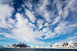 Norway, Svalbard, open fjord in late spring, cloudy sky