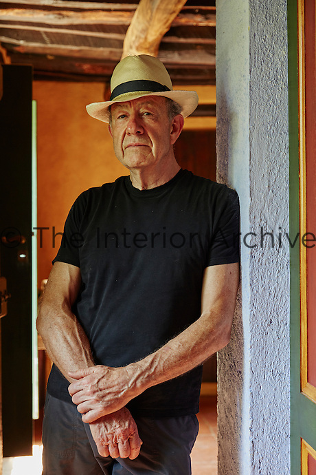 A portrait of designer Anthony Collett in the house he lovingly restored over many years in Tuscany, Italy.