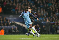 Kelechi Iheanacho of Manchester City leaves Erik Sviatchenko of Celtic during the UEFA Champions League GROUP match between Manchester City and Celtic at the Etihad Stadium, Manchester, England on 6 December 2016. Photo by Andy Rowland.