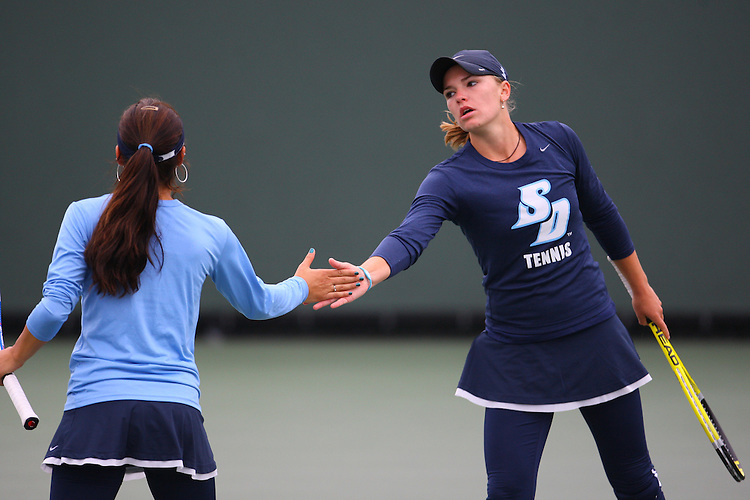 April 21, 2011; San Diego, CA, USA; San Diego Toreros doubles Juliette Coupez and Stephanie Hoffpauir during the first round of the WCC Tennis Championships at the Barnes Tennis Center.