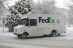 March 5, 2015. Merrick, New York, United States. A FedEx truck is making deliveries as snow is falling yet again on the south shore of Long Island, which is receiving the heaviest snow on L.I., with an accumulation of 6 to 8 inches expected. Many schools closed due to hazardous travel conditions, and a Winter Weather Watch is in effect until 7 PM.