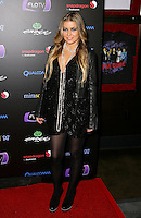 CARMEN ELECTRA .At SWAGG VIP Kid Rock Concert at the Joint inside the Hard Rock Hotel and Casino, Las Vegas, Nevada, USA,.7th January 2010..full length black leather jacket dress tights necklace platform shoes pearls beads .CAP/ADM/MJT.© MJT/AdMedia/Capital Pictures.