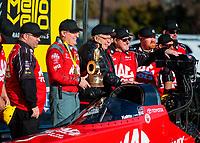 Feb 11, 2019; Pomona, CA, USA; NHRA top fuel driver Doug Kalitta celebrates with crew members after winning the Winternationals at Auto Club Raceway at Pomona. Mandatory Credit: Mark J. Rebilas-USA TODAY Sports