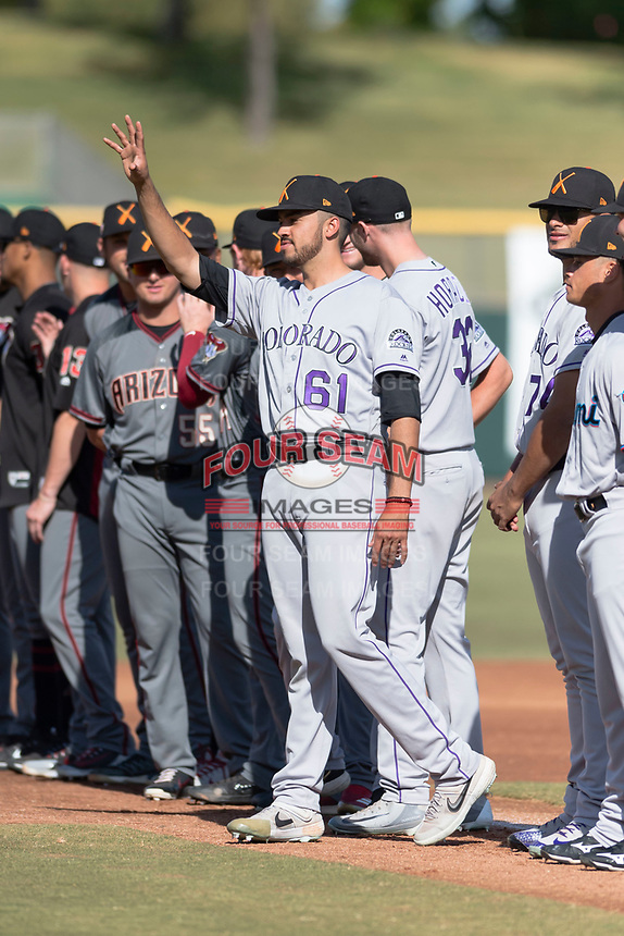 Salt River Rafters pitcher Justin Lawrence (61), of the Colorado Rockies organization, during player introductions before the Arizona Fall League Championship game against the Peoria Javelinas at Scottsdale Stadium on November 17, 2018 in Scottsdale, Arizona. Peoria defeated Salt River 3-2 in extra innings. (Zachary Lucy/Four Seam Images)