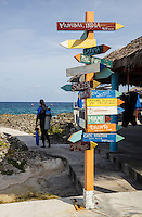 TR90101-D. Scuba diver (model released) about to begin a shore dive. Though most of the dive sites on Grand Cayman are boat access only, there are a few great shore access sites, including Turtle Reef (aka Makabuka) on the northwest side of the island. Cayman Islands, Caribbean Sea.<br /> Photo Copyright &copy; Brandon Cole. All rights reserved worldwide.  www.brandoncole.com