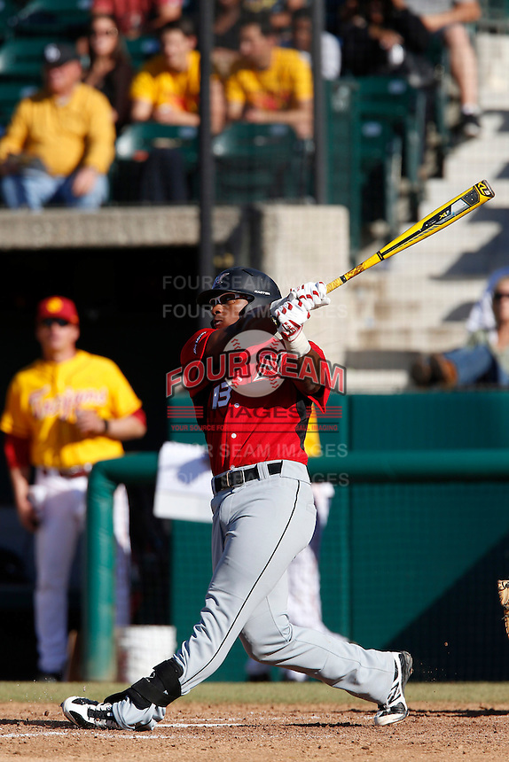 Miles Williams #13 of the Cal State Northridge Matadors bats against the USC Trojans at Dedeaux Field on February 24, 2013 in Los Angeles, California. (Larry Goren/Four Seam Images)