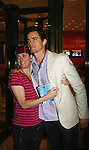 """Guiding Light's Matt Bomer """"Ben Reade"""" and now """"Neal Caffrey on USA's White Collar and fan Donna as a part of White Collar Comes Clean at the Paley Center for Media, New York City, NY on June 7, 2010. (Photo by Sue Coflikn/Max Photos)"""