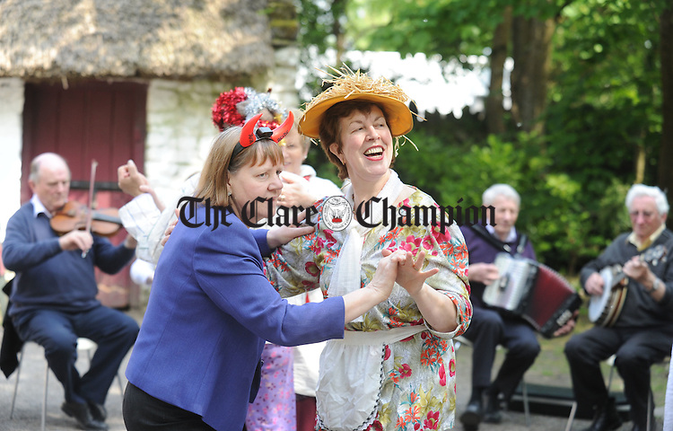 Mary O' Connor from Inch dances with Mary Ita Griffin from Kilmaley during Trad in the Park in Buratty on Sunday which took place as part of An Fleadh Nua. Photograph by Declan Monaghan