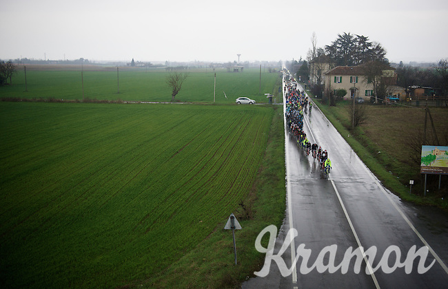 peloton racing over the rainy italian roads<br /> <br /> 106th Milano - San Remo 2015