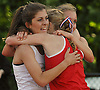 Laurel Fisher of Garden City, left, gets a congratulatory hug from Molly Quinn of South Side after winning the girls' 2,000 meter steeplechase in Day Two of the Nassau County individual championships and state qualifiers at Cold Spring Harbor High School on Friday, June 5, 2015.<br /> <br /> James Escher