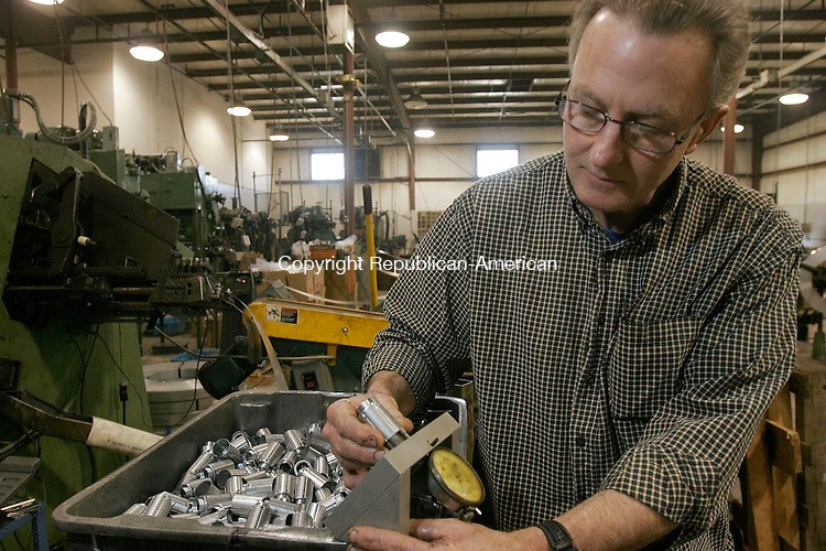 WATERBURY, CT-15 April 2005-041505TK06  Phil Robertson, Tool and Die foreman for Joma Inc., inspects components for automotive electrical accessories. Tom Kabelka staff photo (Phil Robertson, Joma Inc.)CQ