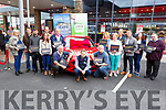 The 14 contestants with their boxes ready to reveal who will be be the lucky 3 persons to go forward for the new Ford Focus draw at Corrib Oil on Saturday.