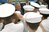 Coronado, Calif. (Aug. 30, 2005) - President George W. Bush pauses to greet and shake hands with San Diego-area Sailors after delivering a speech commemorating the 60th anniversary of the allied victory over Japan (V-J Day) during World War II. The ceremony was held on board Naval Air Station North Island. <br /> Mandatory Credit:  Anthony W. Walker / US Navy via CNP