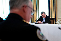 United States Attorney General William P. Barr looks on as US President Donald Trump makes remarks as he participates in a roundtable with law enforcement officials in the State Dining Room of the White House, in Washington, DC, Monday, June, 8, 2020.  <br /> Credit: Doug Mills / Pool via CNP/AdMedia